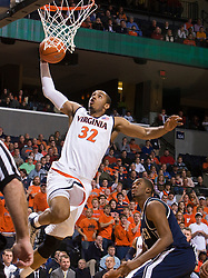 Virginia forward Mike Scott (32) skies for a dunk against Xavier.  The #22 ranked Xavier Musketeers defeated the Virginia Cavaliers 84-70 at the John Paul Jones Arena on the Grounds of the University of Virginia in Charlottesville, VA on January 3, 2009.