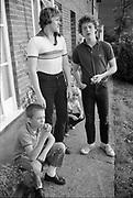 Boys eating apples in garden, UK, 1980s.