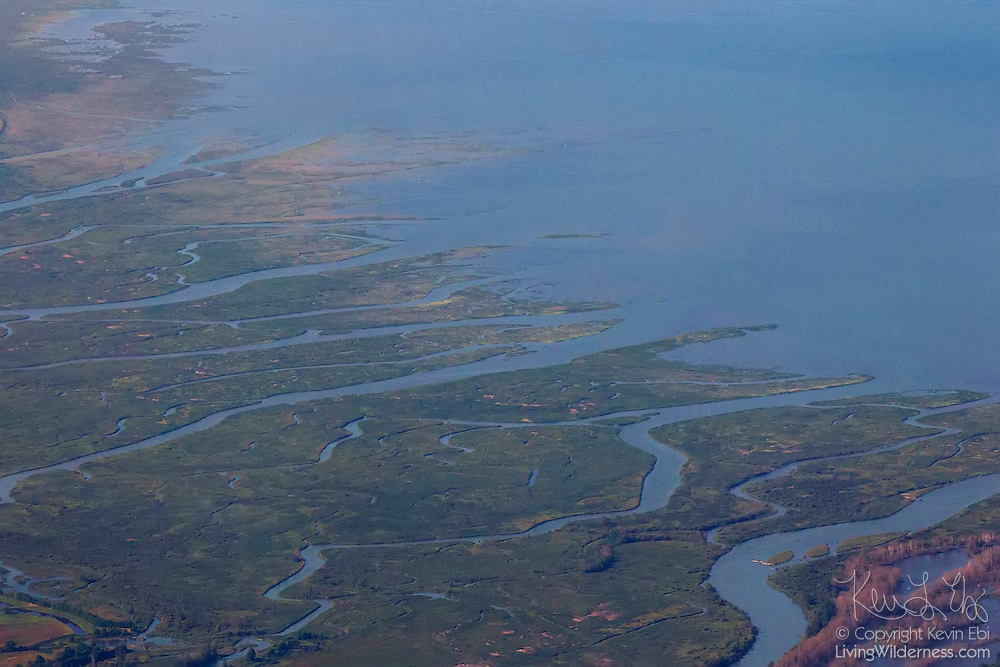 The Skagit River and several sloughs flow through the Fir Island estuary into Skagit Bay in Skagit County, Washington. The estuary is part of the Skagit Wildlife Area. This is an aerial view captured from about 8,000 feet (2,438 meters).