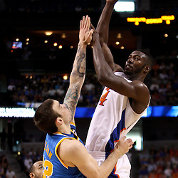 Mar 19, 2011; Tampa, FL, USA; Florida Gators forward/center Patric Young (4) shoots over UCLA Bruins forward Reeves Nelson (22) during first half of the third round of the 2011 NCAA men's basketball tournament at the St. Pete Times Forum.  Mandatory Credit: Derick E. Hingle