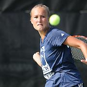 UNCW's Annika Sillanpaa returns a serve against Virginia Tech Saturday September 13, 2014 at UNCW. (Jason A. Frizzelle)