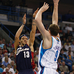 Mar 24, 2010; New Orleans, LA, USA; Cleveland Cavaliers guard Delonte West (13) shoots over New Orleans Hornets forward Darius Songaila (9) during the first half at the New Orleans Arena. Mandatory Credit: Derick E. Hingle-US PRESSWIRE