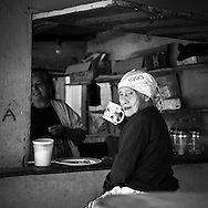 Old woman at the market in Ataco having breakfast
