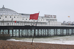 © Licensed to London News Pictures. 31/05/2015. Brighton, UK. The lifeguard service has raised the red flag on the beach due to strong wind and high waves, today May 31st 2015. Photo credit : Hugo Michiels/LNP