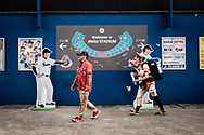 A supporter of the Hiroshima carp and a beer girl enter into the Meiji Jingu stadium on April 21st during the baseball game between the Tokyo Yakult Swallows and the Hiroshima Carp. Tokyo-21/04/2017