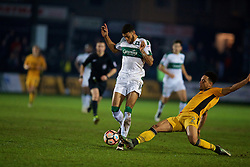 NEWPORT, WALES - Wednesday, December 21, 2016: Plymouth Argyle's Jake Jervis in action against Newport County's Jazzi Barnum-Bobb during the FA Cup 2nd Round Replay match at Rodney Parade. (Pic by David Rawcliffe/Propaganda)