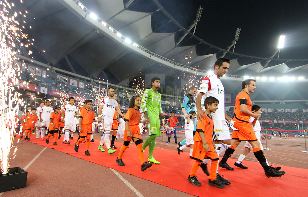Players entering the field during match 16 of the Hero Indian Super League between The Delhi Dynamos FC and NorthEast United FC held at the Jawaharlal Nehru Stadium, Delhi, India on the 29th October 2014.<br /> <br /> Photo by:  Arjun Panwar/ ISL/ SPORTZPICS