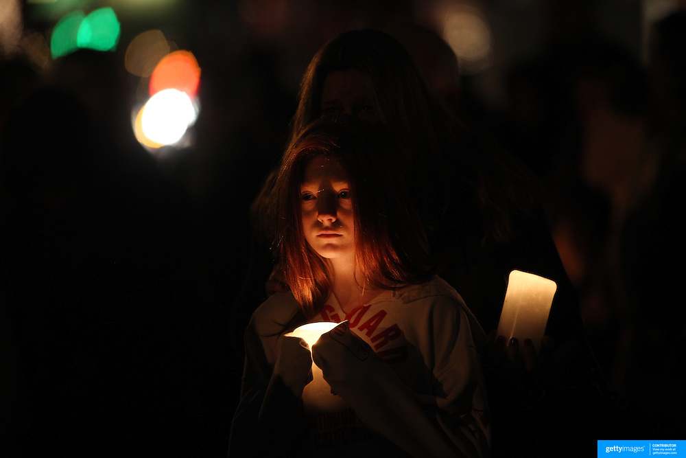 A mother and daughter at a townwide community vigil on Sherman Green. Fairfield, Connecticut after the mass shootings at Sandy Hook Elementary School, Newtown, Connecticut, USA. 17th December 2012. Photo Tim Clayton