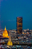 A church spire in foreground with Hotel des Invalides (left) and Tour Montparnasse (right), Paris, France.