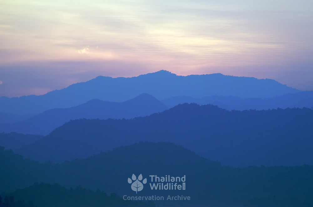 Kaeng Krachan National Park at sunset as seen from the Kaeng Krachan Dam. Kaeng Krachan is Thailand's largest National Park and borders Myanmar.