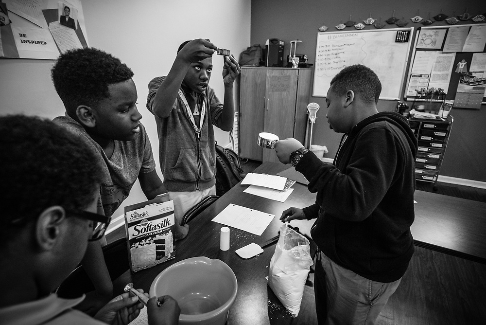 BALTIMORE, MD -- 3/6/17 -- SAFE Center students work together to bake a pineapple upside-down cake as they work on a project directed by visiting mentor Chef Steven Leonard.<br /> <br /> Van Brooks runs the Safe Alternative Center, which he started to give middle school kids in West Baltimore a safe place to learn and play. <br /> <br /> Brooks was a Division 1 prospect when he played football in high school, but was paralyzed in a freak accident after making a tackle in his junior year. He regained the use of his arms, even walking again with much assistance, and graduated on time from high school. He later earned a degree in marketing from Towson University. Though still confined to a wheelchair, he is self-sufficient and runs the center.&hellip;by Andr&eacute; Chung #_AC19373