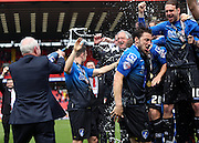 Jeff Mostyn joining in the celebrations during the Sky Bet Championship match between Charlton Athletic and Bournemouth at The Valley, London, England on 2 May 2015. Photo by Matthew Redman.