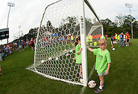 Kyndal Downing and Haley White gather at Robbie Mills Sports Complex Saturday morning for the Laconia Youth Soccer programs opening day ceremony.  (Karen Bobotas/for the Laconia Daily Sun)