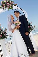 Bride and Groom Under Archway