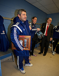 BALLYMENA, NORTHERN IRELAND - Thursday, November 20, 2014: Wales' head coach Osian Roberts with the trophy tucked under his arm as the squad leave the dressing room after beating Northern Ireland 2-0 during the Under-16's Victory Shield International match at the Ballymena Showgrounds. (Pic by David Rawcliffe/Propaganda)
