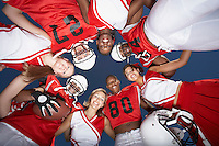 Football Players and cheerleaders in Huddle view from below (view from below)