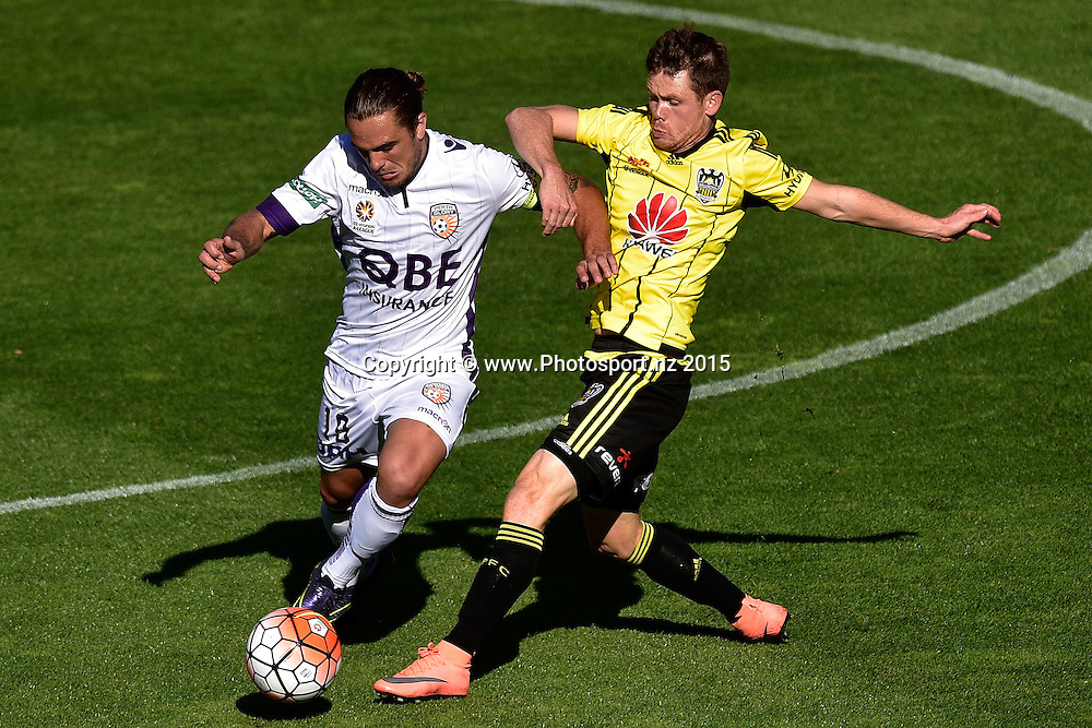 Michael McGlinchey (R of the Phoenix fights for possession with Josh Risdon captain of the Glory during the A-League - Wellington Phoenix v Perth Glory football match at Westpac Stadium in Wellington on Sunday the 20 March 2016. Copyright Photo by Marty Melville / www.Photosport.nz