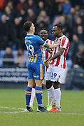 Stoke City forward Saido Berahino (19) and 29 Ollie Norburn for Shrewsbury Town clash during the The FA Cup 3rd round match between Shrewsbury Town and Stoke City at Greenhous Meadow, Shrewsbury, England on 5 January 2019.