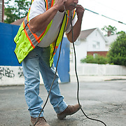 May 6, 2010 - A ruprured underground water main was the latest in what has become a series of misfortunes to befall the residents of Coreal Avenue since construction began on 3050 Corlear Ave.  A DEP worker uses a geophone, which is a device similar to a stethascope, to listen for the sound of water underground.