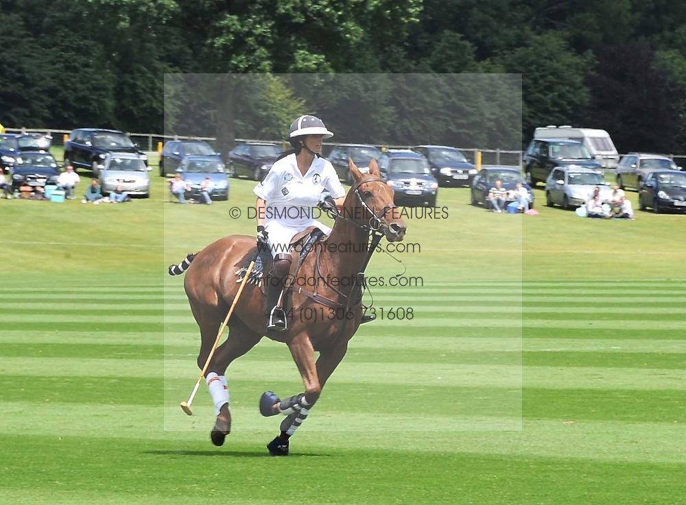 KATIE PRICE - model Jordan, playing polo at a Pro-Celebrity Polo match in aid of the Mark Davies Injured Riders Fund Charity Day held at Cowdray Park, West Sussex on 22nd June 2008.<br />