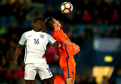 Ronaldo Viera of England Under 20s challenges Carel Eiting of Netherlands Under 20s to a header - Mandatory by-line: Robbie Stephenson/JMP - 31/08/2017 - FOOTBALL - Telford AFC - Telford, United Kingdom - England v The Netherlands - International Friendly