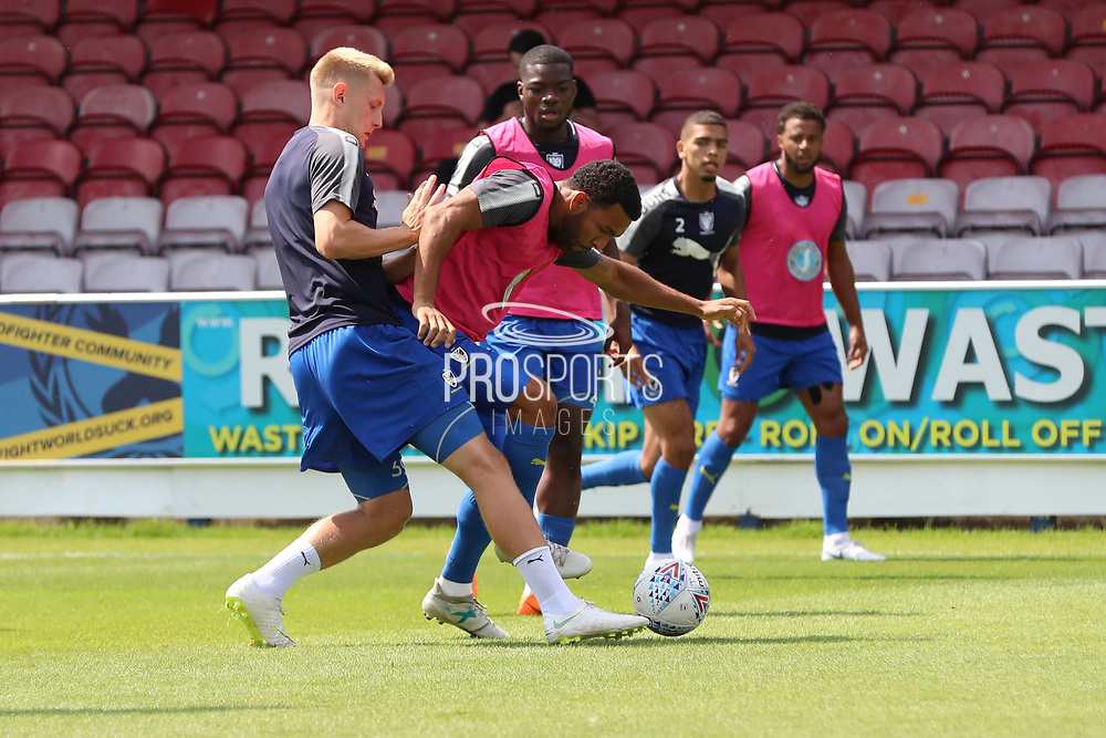 AFC Wimbledon striker Andy Barcham (17) warming up with AFC Wimbledon striker Joe Pigott (39) tackling during the Pre-Season Friendly match between AFC Wimbledon and Queens Park Rangers at the Cherry Red Records Stadium, Kingston, England on 14 July 2018. Picture by Matthew Redman.