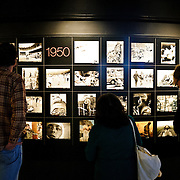 Visitors view an exhibition of all the Pulitzer Prize winning photographs in the Newseum in downtown Washington DC. The Newseum is a 7-story, privately funded museum dedicated to journalism and news. It opened at its current location on Pennsylvania Avenue in April 2008.