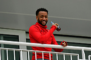 Southampton FC player Nathan Redmond watching the cricket, before the match with Bournemouth, from the Hilton Hotel balcony during the second day of play in the Specsavers County Champ Div 1 match between Hampshire County Cricket Club and Essex County Cricket Club at the Ageas Bowl, Southampton, United Kingdom on 28 April 2018. Picture by Graham Hunt.