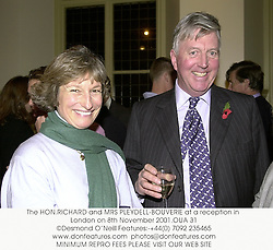 The HON.RICHARD and MRS PLEYDELL-BOUVERIE at a reception in London on 8th November 2001.OUA 31