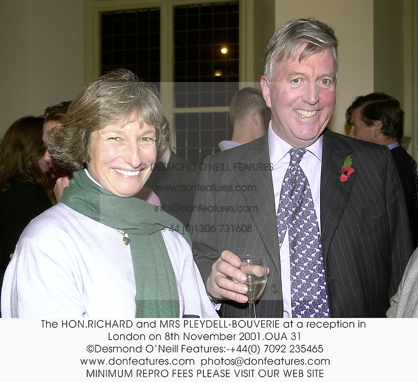 The HON.RICHARD and MRS PLEYDELL-BOUVERIE at a reception in London on 8th November 2001.	OUA 31