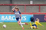 Kayleigh Green (Brighton & Hove) away with the ball after  Jill Roord (Arsenal) falls to the ground during the FA Women's Super League match between Brighton and Hove Albion Women and Arsenal Women FC at The People's Pension Stadium, Crawley, England on 12 January 2020.