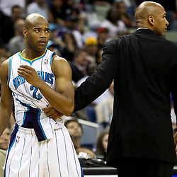 March 30, 2011; New Orleans, LA, USA; New Orleans Hornets head coach Monty Williams holds back point guard Jarrett Jack (2) after he was in a scuffle with Portland Trail Blazers shooting guard Rudy Fernandez (not pictured) during the fourth quarter at the New Orleans Arena. The Hornets defeated the Trail Blazers 95-91.   Mandatory Credit: Derick E. Hingle