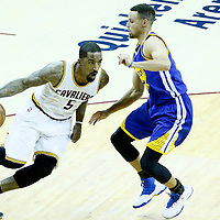 08 June 2016: Cleveland Cavaliers guard J.R. Smith (5) drives past Golden State Warriors guard Stephen Curry (30) during the Cleveland Cavaliers 120-90 victory over the Golden State Warriors, during Game Three of the 2016 NBA Finals at the Quicken Loans Arena, Cleveland, Ohio, USA.