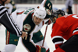 Mar 20, 2009; Newark, NJ, USA; Minnesota Wild right wing Owen Nolan (11) faces off against New Jersey Devils center Dainius Zubrus (8) during the first period at the Prudential Center.