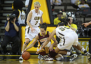 February 18, 2010: Minnesota guard Brittany McCoy (12) and Iowa forward Gabby Machado (50) try to grab a lose ball as Iowa guard Kamille Wahlin (2) looks on during the second half of the NCAA women's basketball game at Carver-Hawkeye Arena in Iowa City, Iowa on February 18, 2010. Iowa defeated Minnesota 75-54.