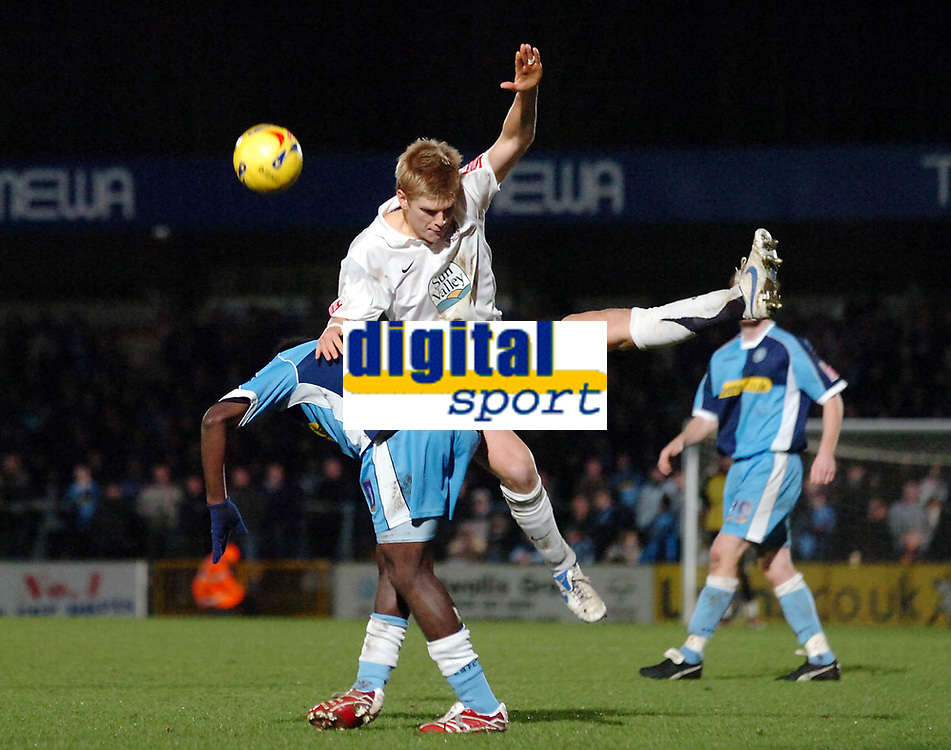 Photo: Kevin Poolman.<br />Wycombe Wanderers v Hereford United. Coca Cola League 2. 01/01/2007. Hereford's Alan Connell climbs over the back of Anthony Grant of Wycombe.