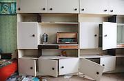 vintage FM radio on white closet with broken doors
