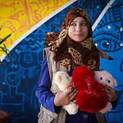 Haneen, 20, and her husband arrived in Azraq last December from Syria. She brought with her wedding gifts from her husband and a teddy bear from her father, who stayed in Syria.<br />