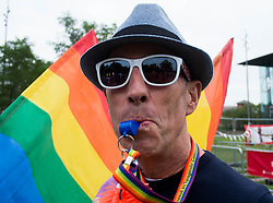© Licensed to London News Pictures. <br /> 27/09/2014. <br /> <br /> Middlesbrough, United Kingdom<br /> <br /> A man blows a whistle during a parade in the centre of Middlesbrough as part of a Pride event that brings together many members of the Lesbian, Gay, Bisexual and Transgender community from the area.<br /> <br /> Photo credit : Ian Forsyth/LNP