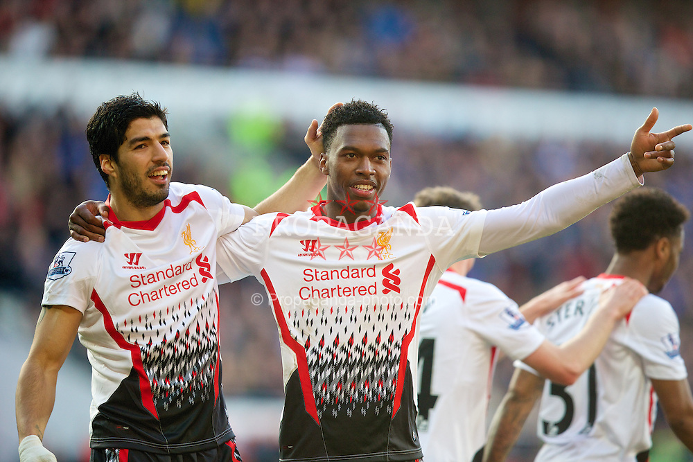 CARDIFF, WALES - Saturday, March 22, 2014: Liverpool's Daniel Sturridge celebrates scoring the fifth goal against Cardiff City with team-mate Luis Suarez during the Premiership match at the Cardiff City Stadium. (Pic by David Rawcliffe/Propaganda)