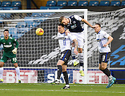 Millwall defender Mark Beevers heads clear in front of Bury defender Peter Clarke during the Sky Bet League 1 match between Millwall and Bury at The Den, London, England on 28 November 2015. Photo by David Charbit.