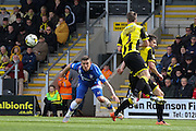 Burton Albion defender Shane Cansdell-Sherriff clears the ball from Gillingham forward Cody McDonald during the Sky Bet League 1 match between Burton Albion and Gillingham at the Pirelli Stadium, Burton upon Trent, England on 30 April 2016. Photo by Aaron  Lupton.