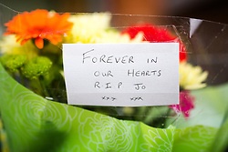 © Licensed to London News Pictures. 16/06/2017. Birstall, UK. Flowers left outside Birstall library this morning at the scene where Jo Cox died last year. Today marks the one year anniversary of the death of Labour MP for Batley & Spen Jo Cox. Jo Cox died after being shot & stabbed by Thomas Mair outside Birstall library where she had been due to hold a constituency surgery. Photo credit: London News Pictures