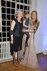 Left to right, The Home Secretary THERESA MAY and LADY JUBIE WIGAN holdingher daughter  ALIENA WIGAN at the Sugarplum Dinner in aid Sugarplum Children a charity supporting children with type 1 diabetes and raising funds for JDRF, the world's leading type 1 diabetes research charity held at One Marylebone, London on 18th November 2015.