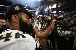 UCF Knights players celebrate beating the Auburn Tigers during the 2018 Chick-fil-A Peach Bowl NCAA football game on Monday, January 1, 2018 in Atlanta. (Jason Parkhurst / Abell Images for the Chick-fil-A Peach Bowl)