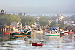 Boats in morning fog.  Corea, Maine.