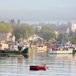 Boats in morning fog.  Corea, Maine.