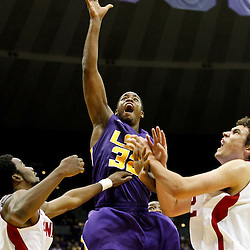 November 12, 2011; Baton Rouge, LA; LSU Tigers guard John Isaac (32) shoots against the Nicholls State Colonels during the first half of a game at the Pete Maravich Assembly Center.  Mandatory Credit: Derick E. Hingle-US PRESSWIRE