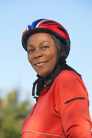 Senior woman wearing cycling helmet, outdoors, portrait