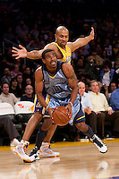 06 November 2009: Guard Mike Conley of the Memphis Grizzles shoots the ball while being fouled by Derek Fisher of the Los Angeles Lakers during the first half of the Lakers 114-98 victory over the Grizzles at the STAPLES Center in Los Angeles, CA.